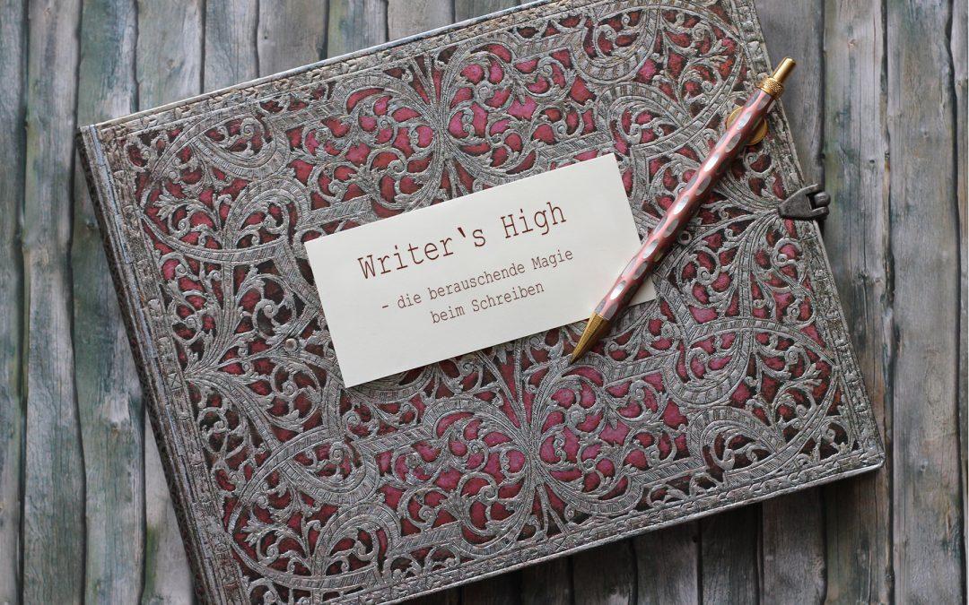 Notizbuch mit Stift und Zettel auf dem steht: Writer's High